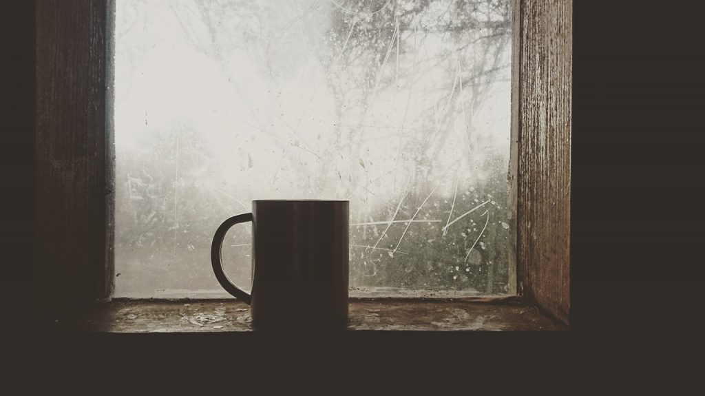 "A mug sits on a windowsill. The window is covered in frost. Image by <a href=""https://pixabay.com/users/israelbest-3433986/?utm_source=link-attribution&utm_medium=referral&utm_campaign=image&utm_content=1711431"">israelbest</a> from <a href=""https://pixabay.com/?utm_source=link-attribution&utm_medium=referral&utm_campaign=image&utm_content=1711431"">Pixabay</a>"