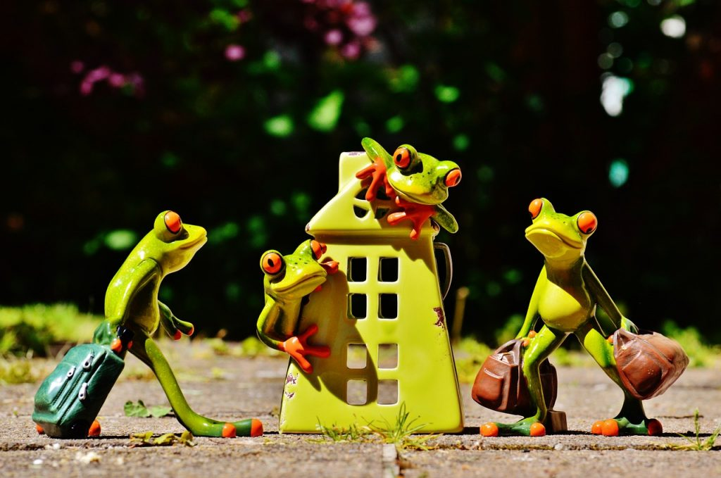 "Frog statues, carrying bags, around a house statue. Image by <a href=""https://pixabay.com/users/Alexas_Fotos-686414/?utm_source=link-attribution&utm_medium=referral&utm_campaign=image&utm_content=1408448"">Alexas_Fotos</a> from <a href=""https://pixabay.com/?utm_source=link-attribution&utm_medium=referral&utm_campaign=image&utm_content=1408448"">Pixabay</a>"